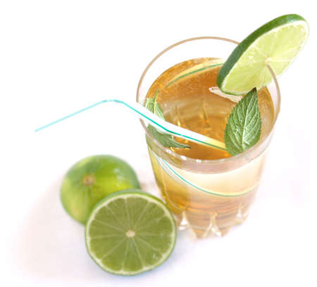 Cocktail mixed alcoholic drink with lime and peppermint photo