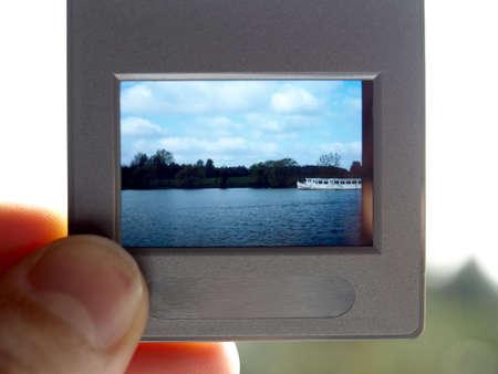 reversal: Hand holding colour slide film