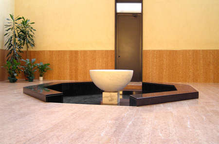 baptismal: Modern baptismal font in a Christian church Stock Photo