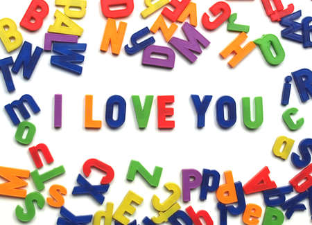 I love you message written with plastic toy characters Stock Photo - 4089042