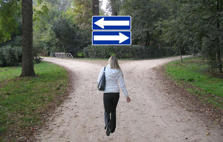 dire: Girl facing a difficult decision at a crossroad Stock Photo