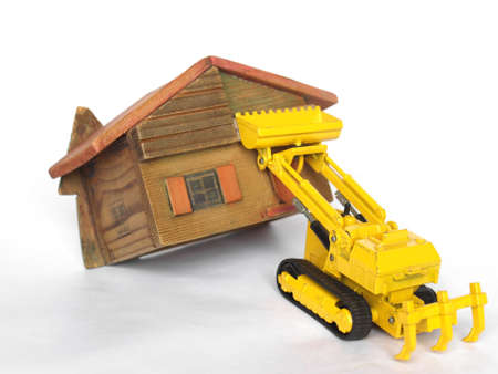 eviction: Eviction from house being demolished with bulldozer Stock Photo
