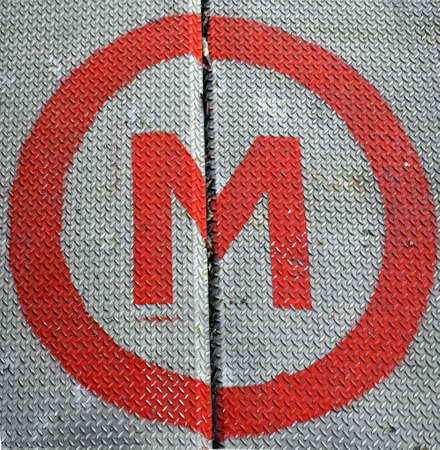Diamond steel plate industrial iron metal background with M symbol (meaning metro underground tube subway) Stock Photo - 4306043