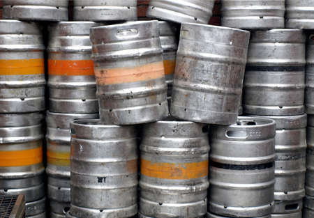Range of stacked beer casks of kegs photo