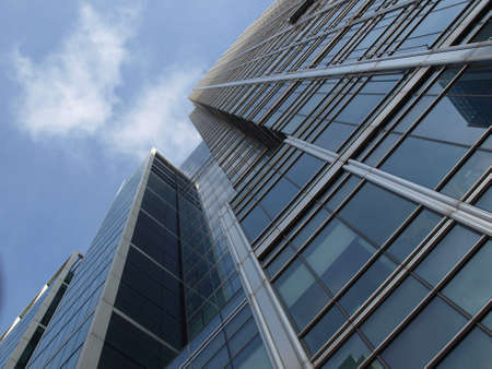 Modern highrise steel and glass architecture in the business district of Canary Wharf, London Docklands, UK photo