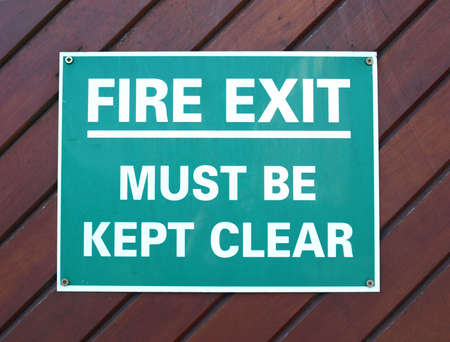 fire exit sign: Fire exit sign with white text over green Stock Photo