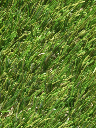 Detail of green grass artificial lawn meadow, useful as a background Stock Photo - 4498837