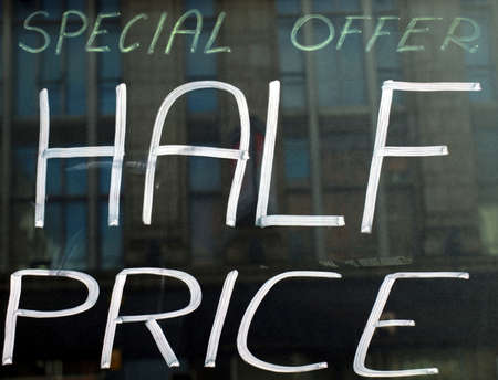 half price: Sign of special offer with Half price