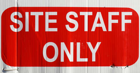 staff only: Detail of site staff only sign in white over red