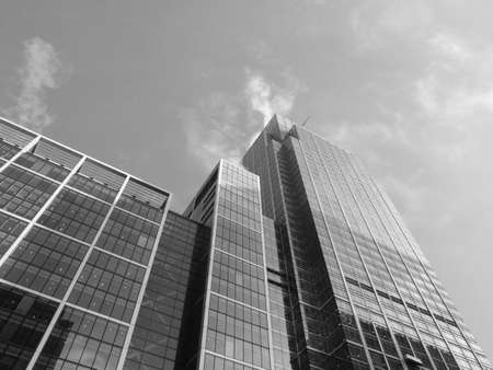 Modern highrise steel and glass architecture in the business district of Canary Wharf, London Docklands, UK in black and white photo