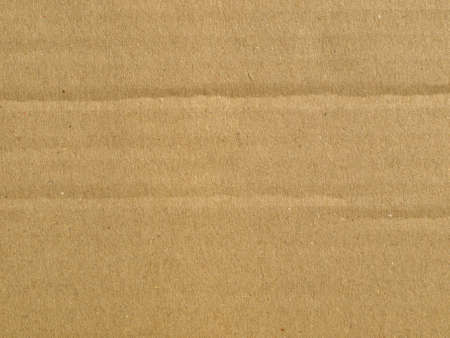 Brown corrugated cardboard sheet background material texture