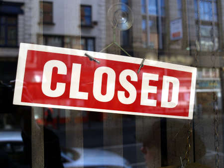 Closed sign in a shop showroom with reflections Stock Photo - 4635115