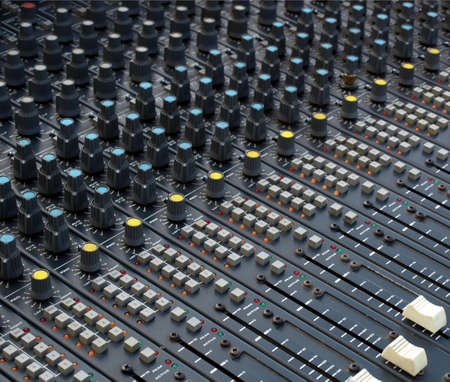 Detail of a soundboard mixer electronic device photo