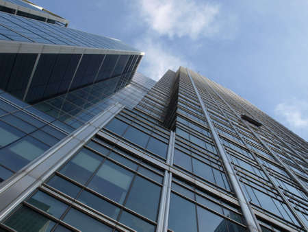 tall glass: Modern highrise skyscraper steel and glass architecture Stock Photo