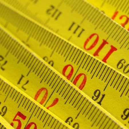 metric: Detail of a wooden metric carpenter ruler Stock Photo