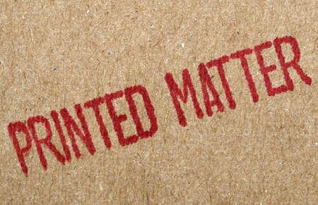 printed matter: Brown cardboard sheet with printed matter text