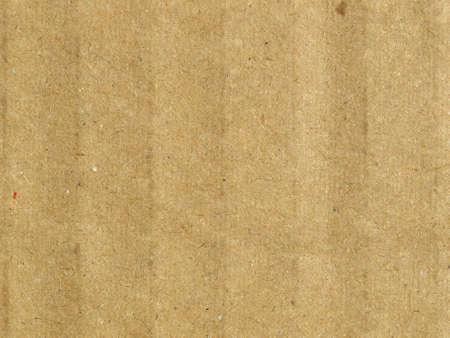 Brown grunge corrugated cardboard sheet useful as a background photo