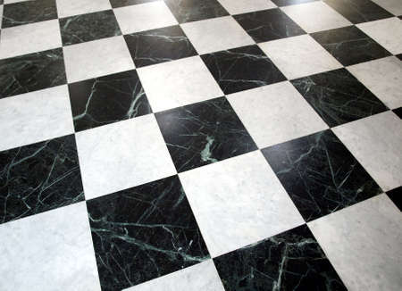 tile cladding: Black and white checked floor useful as a background