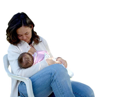 A pretty young brunette mum feeding her baby, isolated over a white background with copy space photo