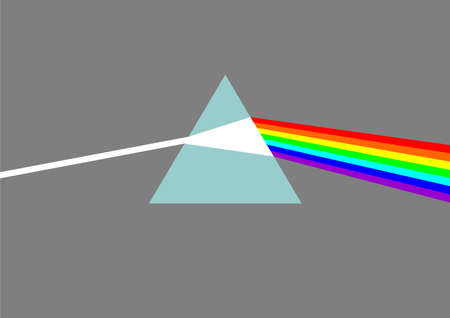 Glass prism dispersing white light into rainbow colors photo
