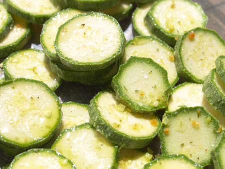 courgettes: Green courgettes or zucchini vegetables useful as a background
