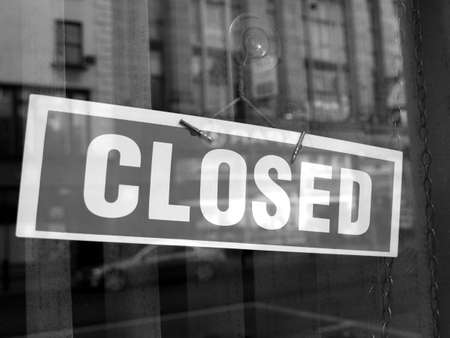 Closed sign in a shop showroom with reflections Stock Photo - 5027092