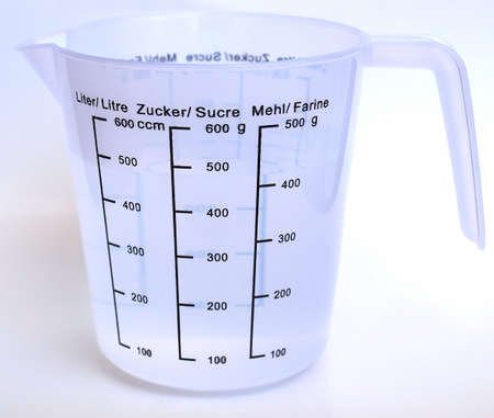 litre: Measuring cup with metric scales for water, sugar and flour
