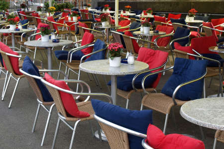 alfresco: Many tables with chairs in alfresco bar Stock Photo