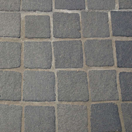 Pavement (sidewalk) with tiles useful as a background photo