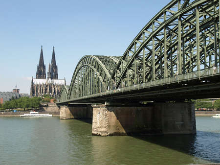 Koeln (Germany) panorama including the gothic cathedral and steel bridge over river Rhine photo