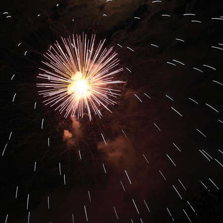 artifice: Fireworks or pirotechnics illuminations over dark black sky