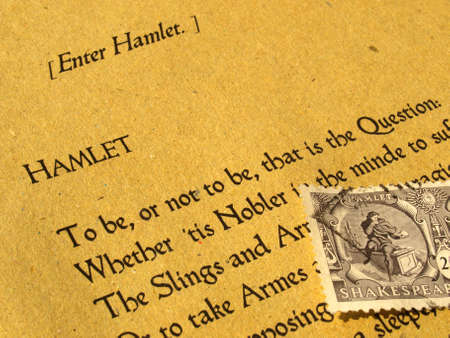 William Shakespeare's Hamlet (original Middle English text from the First Folio of 1623) with stamp - selective focus