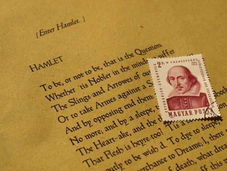William Shakespeare's Hamlet (original Middle English text from the First Folio of 1623) with stamp - selective focus Stock Photo - 5600413