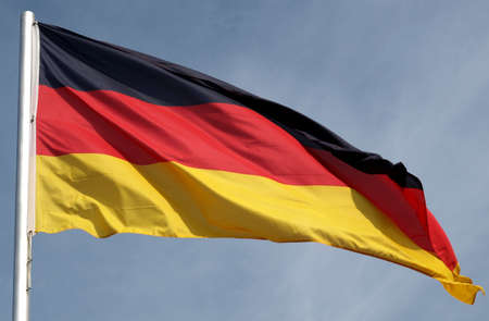 Flag of Germany over a blue sky photo
