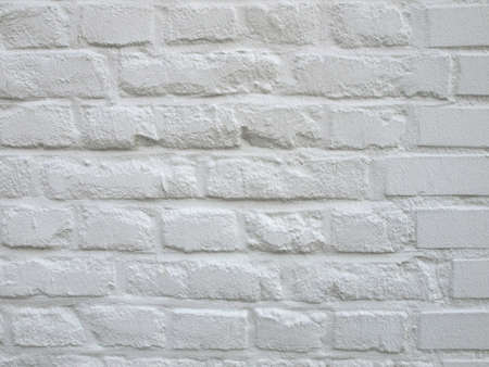 Detail of white brick wall useful as a background Stock Photo