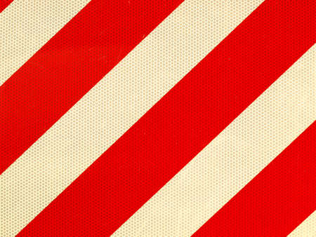 diagonal: Reflective red and white stripes on a traffic sign Stock Photo