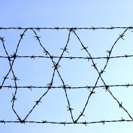 bobbed: Barbed wire over a blue sky background Stock Photo