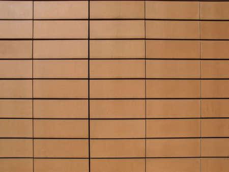 Orange ceramic terracotta tiles as a wall cladding Stock Photo - 5877897