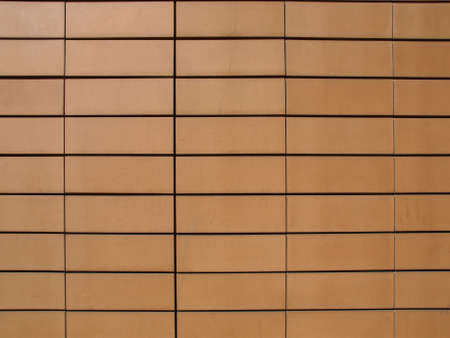 terracotta: Orange ceramic terracotta tiles as a wall cladding Stock Photo