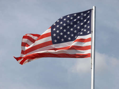 Flag of the USA (United States of America) floating in the wind photo