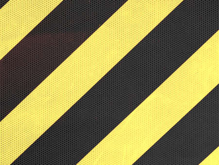 reflect: Reflective yellow and black stripes on a traffic sign