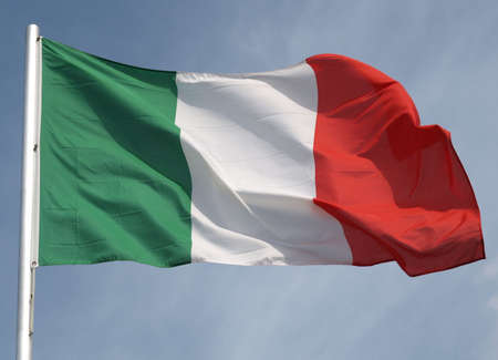 Flag of Italy over a blue sky Stock Photo