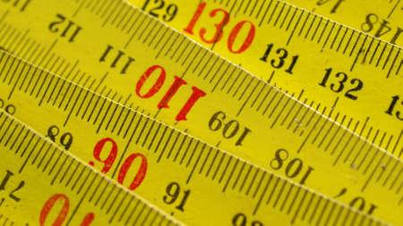 wooden metre: Detail of a wooden metric carpenter ruler Stock Photo