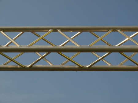 truss: Steel truss beam structure over blue sky background