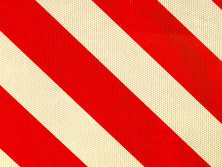 Reflective red and white stripes on a traffic sign photo