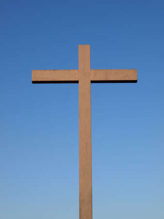 A wooden Christian cross over a blue sky Stock Photo - 6158737
