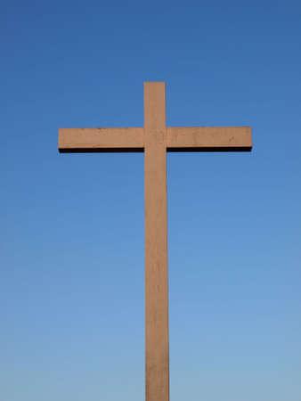 A wooden Christian cross over a blue sky Stock Photo - 6158737
