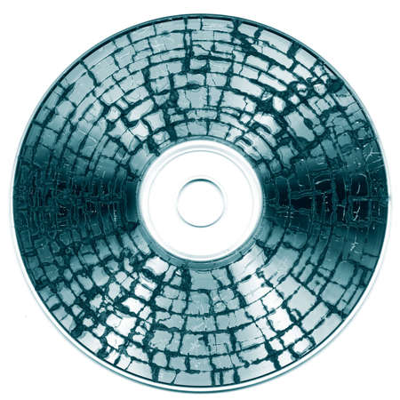Damaged cd media showing the concept of data loss and disaster recovery backup Stock Photo - 6321358
