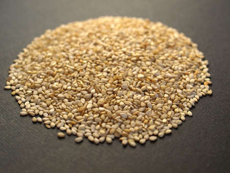 A heap of brown yellow sesame seeds Stock Photo - 6432449