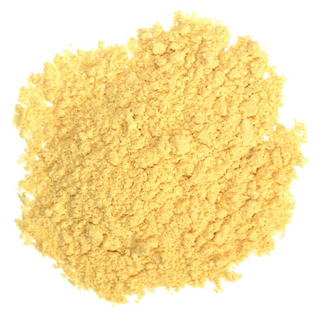 Heap of yellow fine mustard powder spice - isolated over white background photo